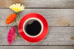 Cup of coffee and gerbera flowers Stock Images