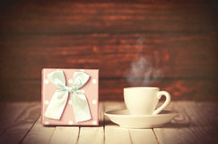 Cup of coffee and gift box Stock Image