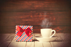 Cup of coffee and gift box Stock Images