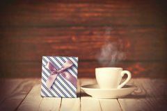 Cup of coffee and gift box Royalty Free Stock Photo
