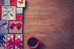 Cup of coffee and gift boxes stock photos
