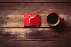 Cup of coffee, gift and cookie in the box Stock Photography