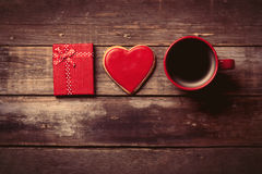 Cup of coffee, gift and cookie Royalty Free Stock Photography