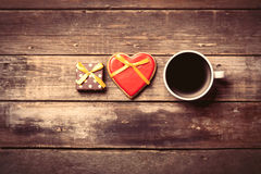 Cup of coffee, gift and cookie Stock Photo