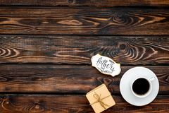 Cup of coffee, gift and copy for Happy Father Day party on wooden background top view copy space. Cup of black coffee, box with gift and copy for Happy Father royalty free stock photo