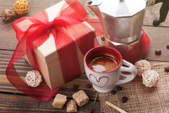 Cup of coffee, gift with red ribbon, brown sugar Royalty Free Stock Image