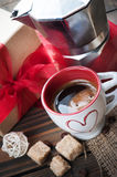 Cup of coffee, gift with red ribbon, brown sugar Royalty Free Stock Photography