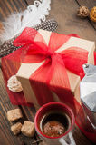 Cup of coffee, gift with red ribbon, brown sugar Royalty Free Stock Photos