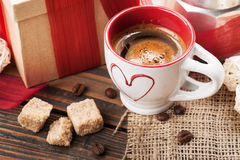 Cup of coffee, gift with red ribbon, brown sugar Stock Photos