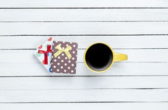 Cup of coffee and gift Stock Images