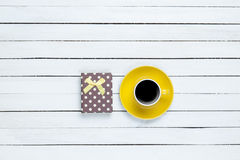Cup of coffee and gift Stock Photo