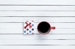 Cup of coffee and gift Royalty Free Stock Images
