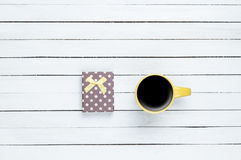 Cup of coffee and gift Stock Photos