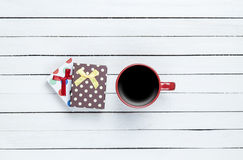 Cup of coffee and gift Stock Photography