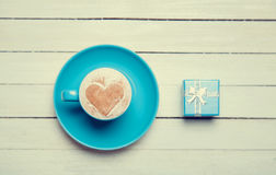 Cup of coffee and gift Royalty Free Stock Image