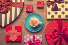 Cup of coffee with gifts. royalty free stock photography