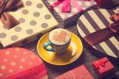 Cup of coffee with gifts. royalty free stock photo