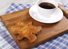Cup of coffee with ginger gingerbreads Royalty Free Stock Photo