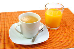 Cup of coffee and glass orange juice. Breakfast. Royalty Free Stock Image