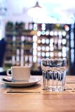 Cup of coffee and glass of water royalty free stock images