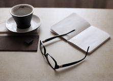 Cup of coffee, glasses Royalty Free Stock Images