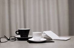 Cup of coffee, glasses Royalty Free Stock Image