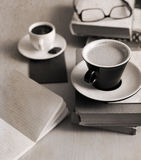 Cup of coffee, glasses, notebook, books Stock Image