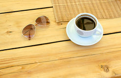 Cup of coffee, glasses, water on table. Relax time with empty space on table Stock Photo