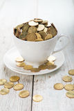 Cup of coffee with gold coins Royalty Free Stock Images