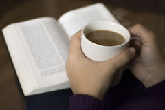 Coffee. Book reading with hot coffee Royalty Free Stock Photography