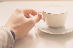 A cup of coffee. A cup of coffee for good morning.Drinking a morning cup of coffee.Daily routine.Holding a cup of coffee royalty free stock image