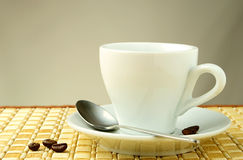 Cup of coffee on gradient Stock Images