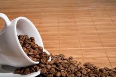 Cup with coffee grain Royalty Free Stock Images