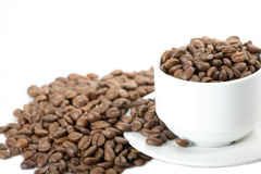 Cup with coffee grains Royalty Free Stock Image