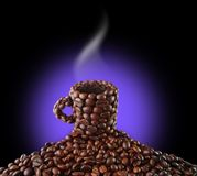 Cup from coffee grains. On a black background Stock Photography