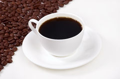 Cup of coffee with grains Royalty Free Stock Photography