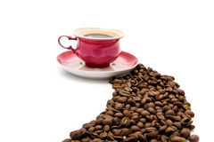Cup of coffee with grains Royalty Free Stock Images