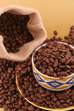Cup of coffee grains. Cup full of coffee grains and coffee canvas bag stock images
