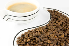 Cup and coffee grains Royalty Free Stock Image