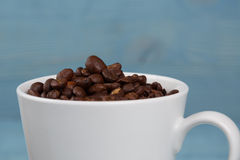 Cup with coffee grains Stock Photo