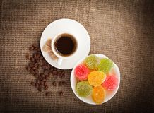 Cup of coffee, grains on burlap background Stock Photo
