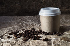 Cup of coffee and grains of coffee Stock Images