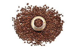 A cup of coffee and grains scattered on a white background Royalty Free Stock Image