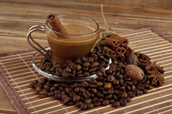 Cup of coffee, grains, and spices against Stock Photography
