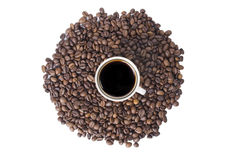 Cup of coffee on grains Stock Images