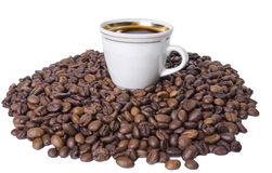 Cup of coffee on grains Stock Photography