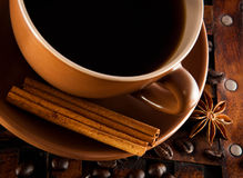 Cup of coffee on grange a background Stock Image