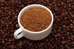 Cup of coffee granules Royalty Free Stock Photo