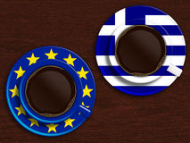 Cup of coffee with greek flag and european union flag Royalty Free Stock Photography
