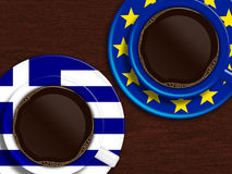 Cup of coffee with greek flag and european union flag Royalty Free Stock Image